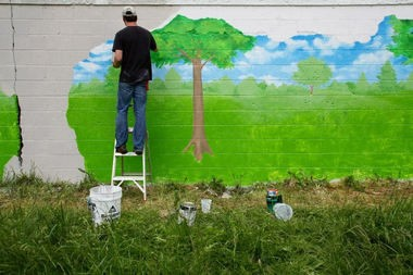 David Zinn working on the mural earlier this year.
