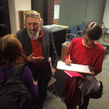 Alan Haber collects petition signatures to put the question of a downtown central park on the Library Lot at the Ann Arbor City Council meeting on Nov. 5, 2015.