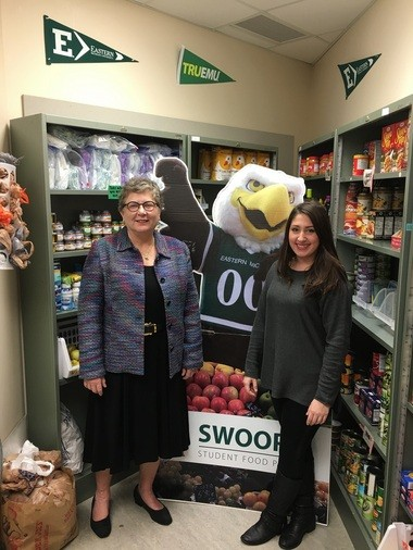 Swoop's Food Pantry founder and EMU student Haley Moraniec and EMU interim president Kim Schatzel pose in the food pantry.