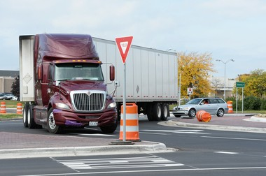 A semi truck passes through a roundabout at the intersection of State and Ellsworth roads in Pittsfield Township on Friday, October 4, 2013.