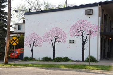 Cate Tinsley's magnolia tree mural on Jefferson Street near Main Street in Ann Arbor on May 19, 2016.