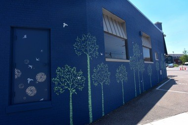 A stencil mural Rebecca Arends did last year on South Ashley Street in Ann Arbor.