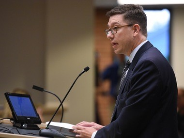 Michael Miller, the regional chief mission officer at St. Joseph Mercy Health System, speaks in support of the Tobacco 21 ordinance at the Ann Arbor City Council's meeting on Aug. 4, 2016.