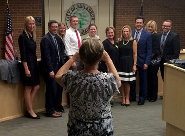 Some of the members of the anti-tobacco lobby pose for a group photo in the Ann Arbor council chambers following passage of the city's Tobacco 21 ordinance Thursday night, Aug. 4, 2016.