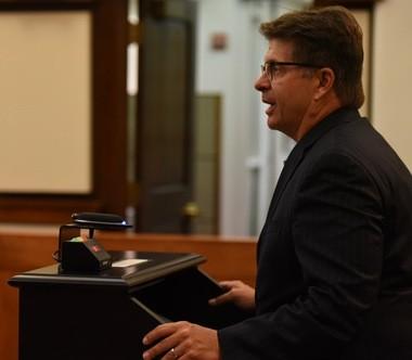 Ann Arbor SPARK CEO Paul Krutko addresses Washtenaw County commissioners on Oct. 5, 2016.