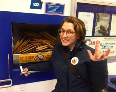 Katy Lind ships out a batch of Pincause pins at the Post Office in Ann Arbor. She said someone in San Francisco ordered 50 pins.
