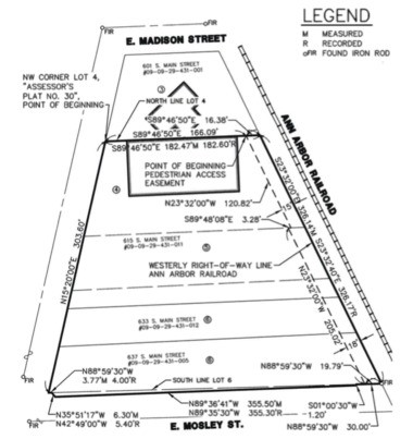 A drawing showing a pedestrian access easement along the east side of the property at 615 S. Main St. between Madison and Mosley.