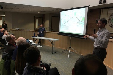 Oliver Kiley, a landscape architect with SmithGroupJJR, gives a presentation on Allen Creek Greenway trail route options during a community meeting at Ann Arbor's city hall on Feb. 16, 2017.