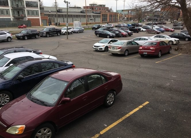A public parking lot at First and William streets in downtown Ann Arbor on March 29, 2017. The city has plans to turn this into a greenway park someday, along with another nearby city-owned parking lot at 415 W. Washington St. There are 262 parking spaces right now between the two lots.