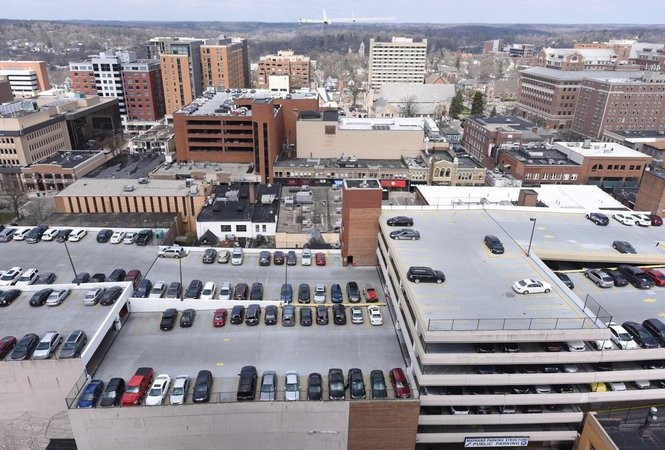 None of Ann Arbor's city-owned parking garages have solar panels atop them, but city leaders are talking about it. Here the Maynard parking garage is viewed from Tower Plaza on April 11, 2017.
