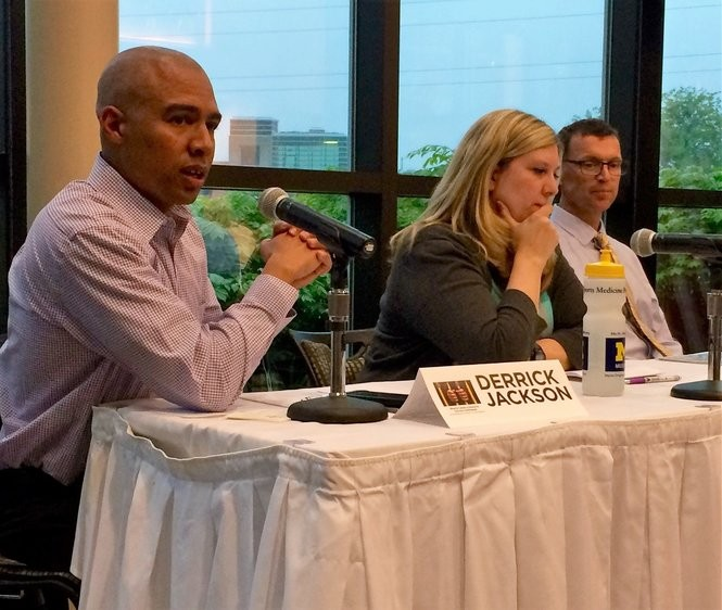Derrick Jackson, director of community engagement for the Washtenaw County Sheriff's Office (left), speaks on a school-to-prison pipeline panel on Wednesday, May 24, 2017. Peri Stone-Palmquist, executive director of the Student Advocacy Center (center), and Joseph Ryan, associate professor of social work at UM, also participated in the panel.