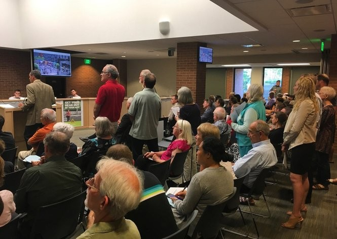 People line up to speak about the proposed redevelopment of 1140 Broadway St. at the Ann Arbor Planning Commission meeting on July 5, 2017.