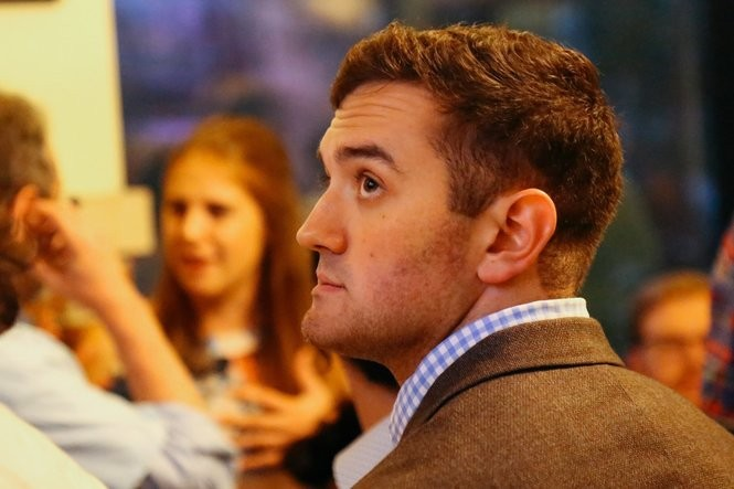 Ann Arbor City Council Member Zachary Ackerman, D-3rd Ward, looks at live election results at an election party at Pizza House in Ann Arbor on Tuesday, Aug. 8, 2017.