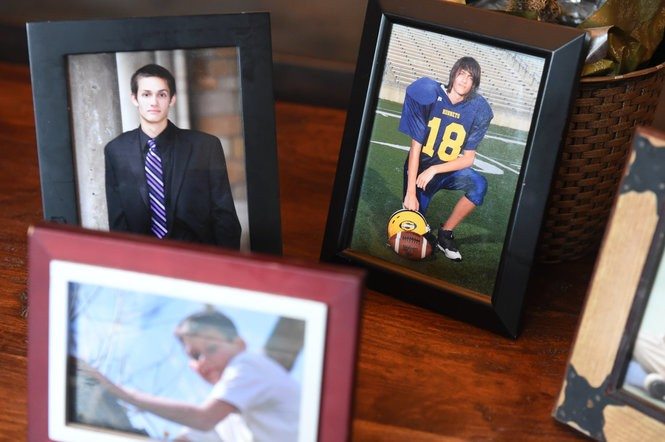 Framed photos of Garrick Roemer as a Saline High School senior, who who committed suicide in 2014. Melanie Maxwell | The Ann Arbor News