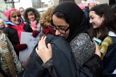 Community High School student and daughter of Yousef Ajin, Betoul, right, hugs family following an immigration hearing where a judge allowed her father to remain in the country at the McNamara Federal Building in Detroit on Tuesday, February 28, 2017. (Melanie Maxwell | The Ann Arbor News)