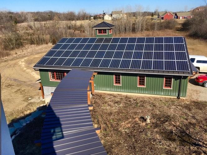 A 60-panel, 16.8-kilowatt solar array on the south-facing roof of a barn at Beacon Springs Farm at 3200 Tessmer Road outside Ann Arbor on Feb. 27, 2018. The panels provide more than enough energy to power the barn and adjacent farmhouse. (Ryan Stanton | The Ann Arbor News)