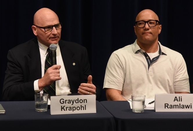 Ann Arbor City Council Member Graydon Krapohl, D-4th Ward, left, speaks at a candidate forum at the University of Michigan on April 12, 2018. Seated next to him is Ali Ramlawi, a 5th Ward council candidate. (Ryan Stanton   The Ann Arbor News)