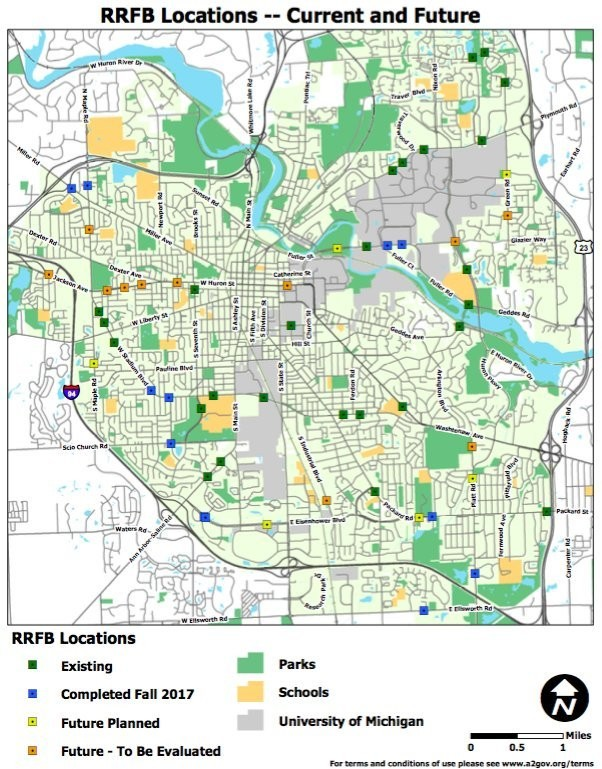 A map showing the locations where the city of Ann Arbor, as of 2017, had installed flashing crosswalk signals known as RRFBs or rectangular rapid flashing beacons, and where more might be installed.