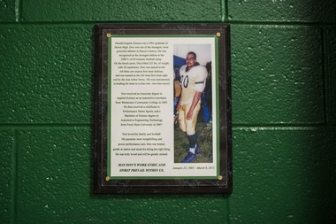 A memorial plaque of the late 2001 Huron High graduate Donald Simons hangs in the weight room at Huron High School on Thursday, September 25, 2014 in Ann Arbor. Katie McLean | The Ann Arbor News
