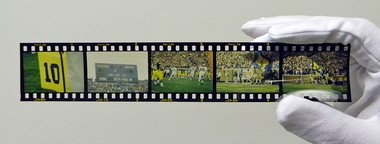 A slide of negatives from the Ann Arbor News archive of University of Michigan athletic photos that the Michigan History Project is working on digitizing.