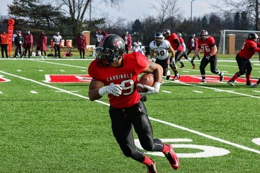 Concordia University Ann Arbor junior wide receiver Corey Turner turns after catching a pass at Cardinal Field on November 15, 2014. CUAA played its first season on its new turf in 2014.