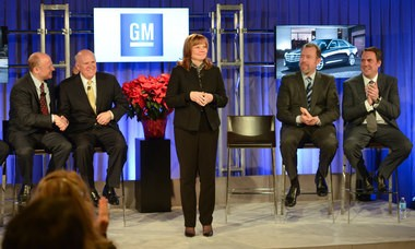 New General Motors CEO Mary Barra addresses a Town Hall meeting of employees Tuesday, Dec.10, 2013 at the GM Renaissance Center Global Headquarters in Detroit, Michigan. Looking on are (l to r) Steve Girsky, who will assume a new senior advisor role with the company; Current Chairman and CEO Dan Akerson who's last day will be January 15, 2014; new GM President Dan Ammann; and new Executive Vice President, Global Product Development, Purchasing and Supply Chain Mark Reuss. (Photo by Steve Fecht for General Motors)