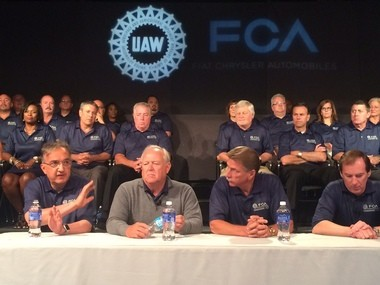 FCA CEO Sergio Marchionne, UAW President Dennis Williams, UAW Vice President Norwood Jewell and FCA Head of Employee Relations Glenn Shagena answer questions from the media at a handshaking ceremony in Detroit on July 14.