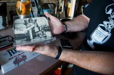 """A photo of John Lennon scrapbooked from a magazine in a standup acrylic frame. """"More people want to buy this than anything else, but I won't sell it,"""" said Brad Wilderman, owner of Beatles and Beans Coffee Emporium, 916 N. Water St. in Bay City."""