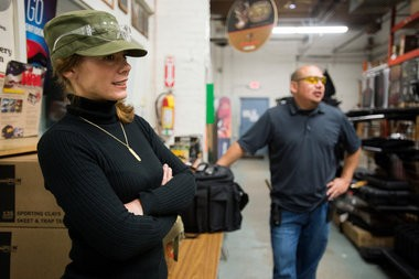 Shelley Gottschling, left, and Ray Rocha talk about concealed pistol licenses Wednesday, Oct. 29, at Duncan's Outdoor Shop, 501 Salzburg Ave. in Bay City.