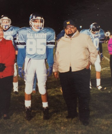 Matthew Felan, left, and his father, Fabian Felan, pose for a portrait during senior night at All Saints Central High School in 1992.