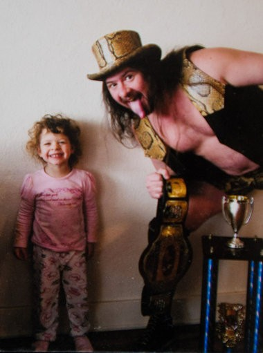 Viper Pete Christie in his wrestling outfit with daughter, Cassidy, when she was 3 years old.