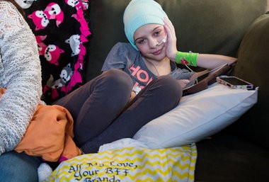 Cassidy Christie, 10, who is battling cancer, sits in her spot on the couch Wednesday, Feb. 18, at home in Bangor Township.