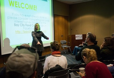 Christa Schubert welcomes attendees to a community meeting about a Bay City food co-op Thursday, March 5, in the community room at the Alice and Jack Wirt Public Library, 500 Center Ave. in downtown Bay City.