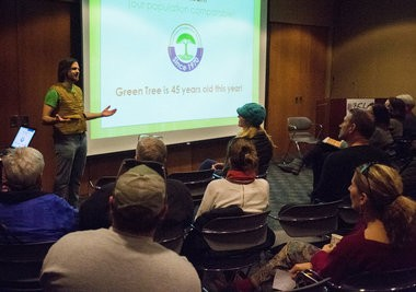 Jordan Pries talks about GreenTree Cooperative Grocery as an example during Bay City food co-op public meeting Thursday, March 5, in the community room at the Alice and Jack Wirt Public Library, 500 Center Ave. in downtown Bay City. (Yfat Yossifor | The Bay City Times)