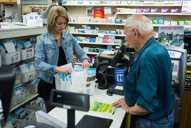 Stephanie Valley pulls a prescription package for Calvin Lehmann Tuesday, June 9, at Monitor Pharmacy, 2981 Midland Road in Monitor Township. Owner Michael Bouckaert sold the pharmacy side of the business to CVS.