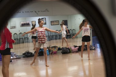 Elizabeth Wirth goes through a dance routine during the final practice for the Miss Bay County Pageant at Perry Woodard School of Dance Tuesday, July 14, in Bay City.