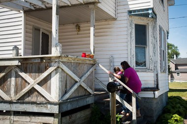 Addison Lenea, 9, and her mother Kelly McLean walk up the front stairs of their Jenny Street home in Bay City Thursday, July 16. The home is part of the Bay County Habitat for Humanity Neighborhood Revitalization program that starts Monday, July 20.