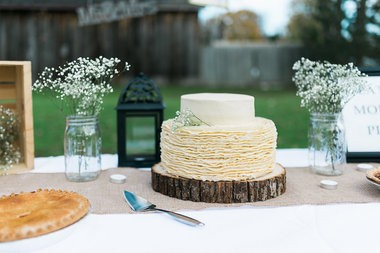 Newlyweds Heather and Matt Koehler were surprised with a wedding re-enactment photo shoot on Oct. 25 after the photographer they hired for their September wedding ended up being a no-show. Bay City photographer Dana Gruszynski arranged the session. Shown is the wedding cake that was recreated for the shoot.