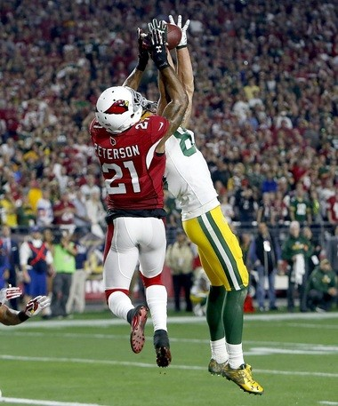Green Bay Packers wide receiver Jeff Janis (83) makes a catch for a touchdown as Arizona Cardinals cornerback Patrick Peterson (21) defends during the second half of an NFL divisional playoff football game, Saturday, Jan. 16, 2016, in Glendale, Ariz. (AP Photo/Rick Scuteri)