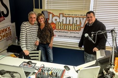From left, Johnny Burke, Blondie, whose real name is Bonnie Belger-Holzhei, and Josh Sharrow pose for a photo inside the temporary studio for the Johnny and Blondie morning radio show. After being let go from WHNN 96.1 FM, Burke and Belger-Holzhei are now streaming their morning radio show over the Internet in a studio in downtown Bay City.