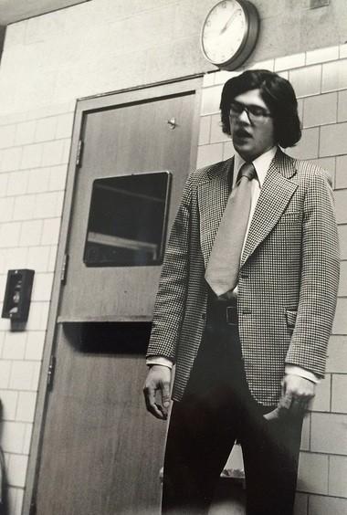 Jim Deming addresses his All Saints junior varsity basketball team during the 1975 season. (Dick Van Nostrand | Bay City Times)