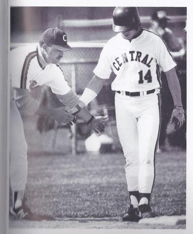 Jason LeCronier gets congratulations from coach Tom Merkle during the 1991 season for Bay City Central. (Bay City Times file)