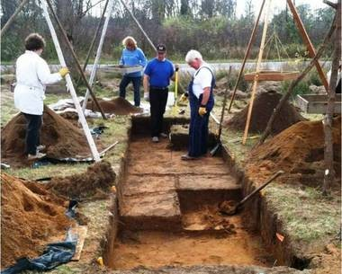 Volunteers from the Michigan Archeological Society helping excavate Dan Wymer's site near Stony Lake in 2011.