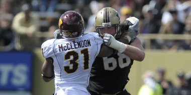 Western Michigan junior right tackle Dann O'Neill, of Grand Haven, blocks Central Michigan's Kenny McLendon during a game in 2011. O'Neill signed with the Houston Texans Saturday night.