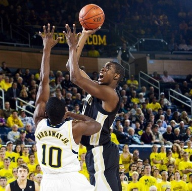 WMU freshman forward Darius Paul goes up for a shot over Michigan's Tim Hardaway Jr. during a Dec. 4 game in Ann Arbor. Paul has scored in double-figures in 11 of his first 13 college games, and posted double-doubles in three of them.