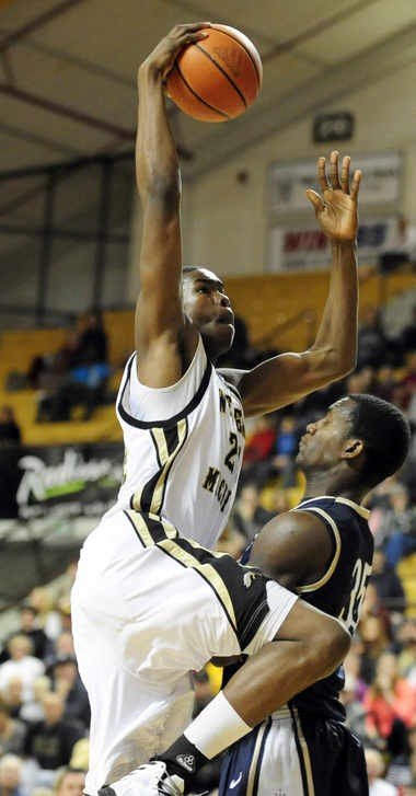 Darius Paul is fouled by Mount St. Mary's Raven Barber as he goes up for a dunk attempt during a Dec. 22 game at University Arena. Paul scored a career-high 19 points that day.