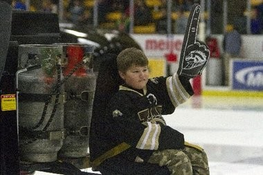 A young Western Michigan fan rallies the crown while riding a zamboni between periods of Western Michigan's hockey game at Lawson Ice Arena on Jan 11.
