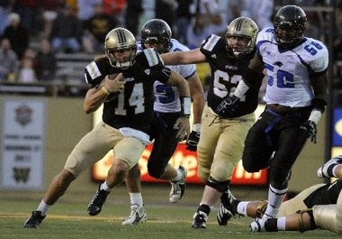 Western Michigan quarterback Alex Carder gets outside of the block of Kevin Galeher (62) during a game last season. The two seniors will participate in WMU's Pro Day on Tuesday.