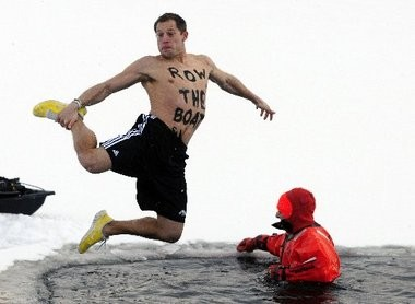"""Western Michigan football coach takes the Polar Plunge on Feb. 16, with """"Row The Boat"""" painted on his chest."""