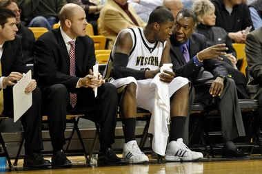 Larry Farmer, far right, talks to Flenard Whitfield during Farmer's previous stint with the WMU basketball program.